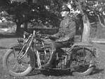 Trooper on early motorcycle